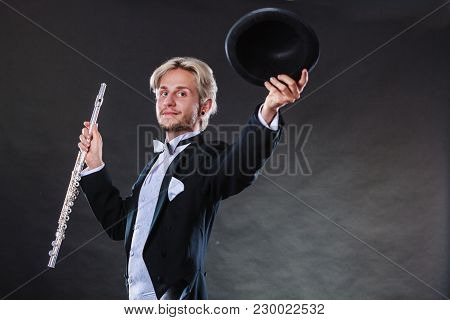 Classical Music, Passion, Hobby Concept. Elegantly Dressed Musician Man Holding Flute And Black Fedo