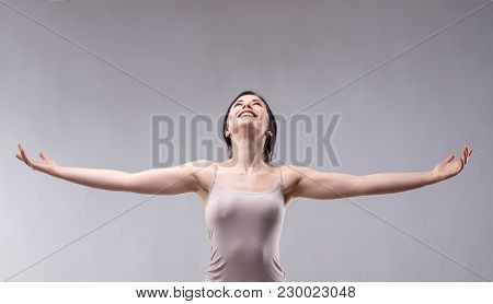 Happy Attractive Young Woman Rejoicing
