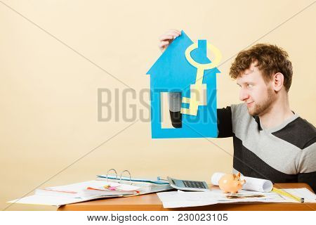 Dream About Stabilization And Family. Young Man With Paper House And Big Key. Dreaming Boy Full Of P