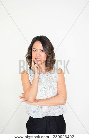 Portrait Of Young Asian Woman Wearing Blouse Standing And Listening With Attention. Interest Concept