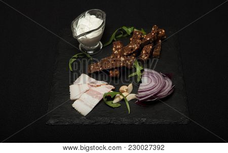 Ukrainian National Food Is Lard Salo With Bread With Purple Onions On The Black Background.