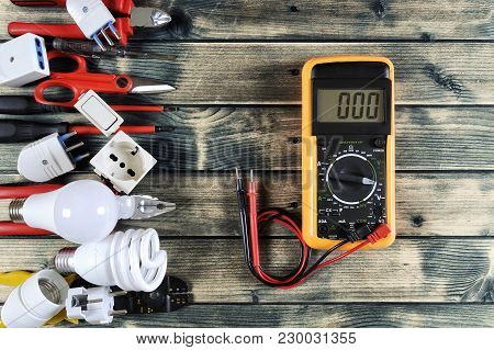 Close-up Of Work Tools And Electrical Equipment On An Antique Wooden Table With Space For Text / Ann