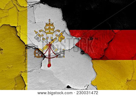 Flag Of Vatican And Germany Painted On Cracked Wall