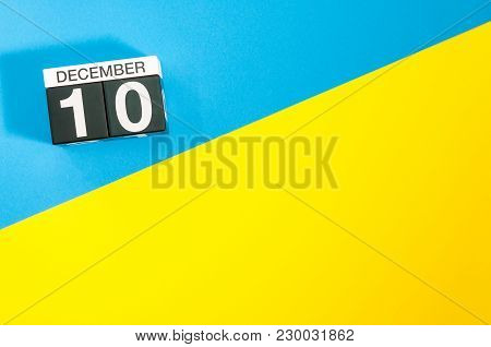 March 10th. Day 10 Of March Month, Calendar On Blue And Yellow Background Flat Lay, Top View. Spring