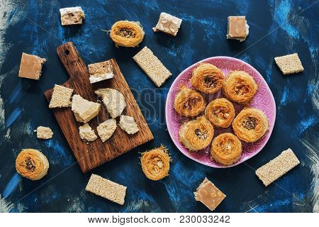Baklava, Sherbet And Halva On A Blue Background. View From Above. Eastern Food