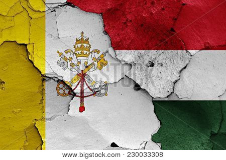 Flag Of Vatican And Hungary Painted On Cracked Wall