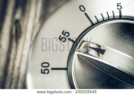55 Minutes - Macro Of An Analog Chrome Kitchen Timer On Wooden Table