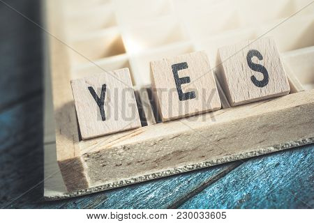 Closeup Of The Word Yes Formed By Wooden Blocks In A Typecase