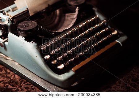 Old Typewriter In A Dark Room With Dim Warm Light
