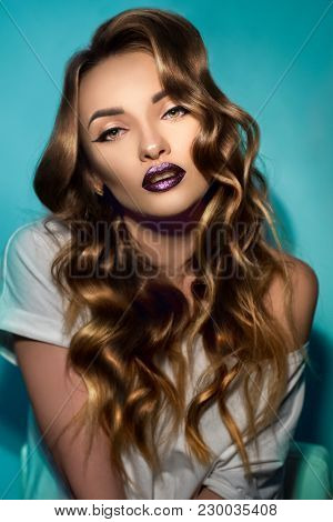 Sexy Young Girl With Perfect Curly Hairstyle And Gloss Magenta Lips Looking At The Camera In Studio