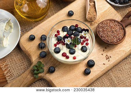 Cottage Cheese Blended With Flax Seed Oil, Topped With Fresh Blueberries, Frozen Wild Cranberries An