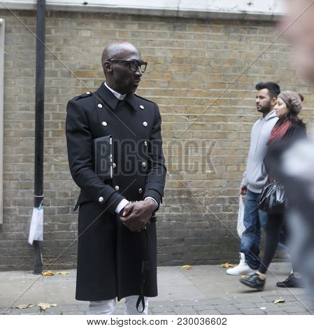 London, England - July 12, 2016 A Fashionable Black Man Stands Opposite The Brick Wall At Brick Lane
