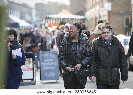 London, Uk - April 22, 2016: A Motley Crowd Walks Along The Brick Lane