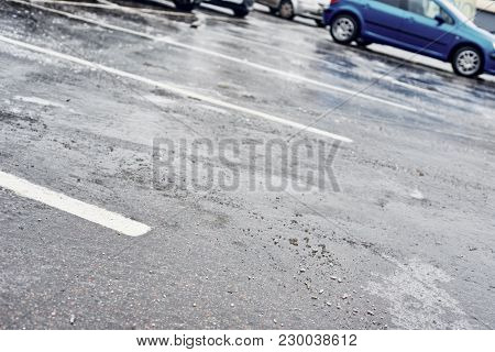 Closeup Of Icy Asphalt Road On Car Parking In Winter