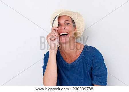 Close Up Older Woman Laughing With Hat Against White Background
