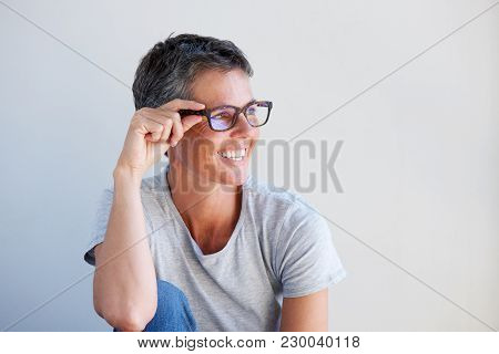 Close Up Beautiful Older Woman Smiling With Glasses Against White Background