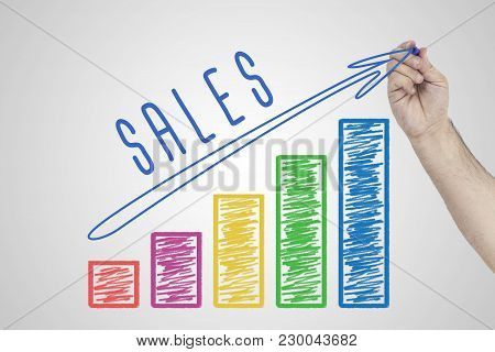 Sales Performance. Hand Drawing Increasing Business Chart Showing The Growth In Sales.