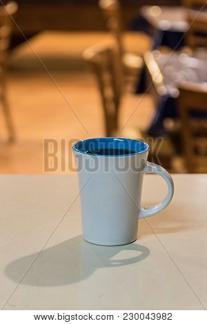 Cup Of Freshly Brewed Coffee On Waiting On Counter Top At Breakfast Cafe.