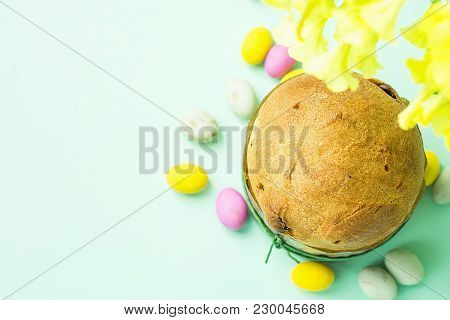 Home Baked Easter Sweet Cake Panettone In Paper Form Multicolored Speckled Chocolate Candy Eggs Scat