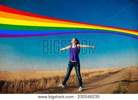 Happy Brunet Girl And Rainbow On Background At Countryside Outdoor