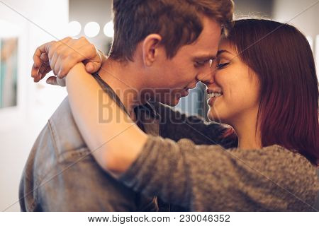 Tenderness Moments Between Two Young People, With Happy Face Expressions While Smiling, Looking To E