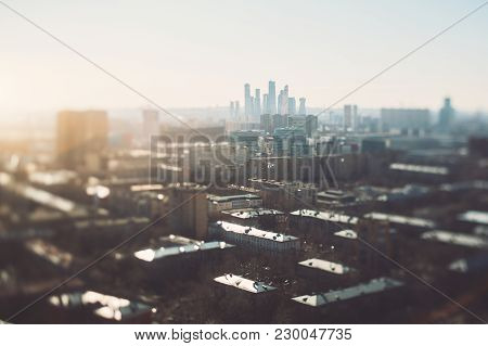 True Tilt-shift View Of Cityscape With Focus Corridor Going From Of The Shot Right To The Group Of B