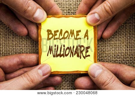 Conceptual hand writing showing Become A Millionaire. Business photo showcasing Ambition To Become Wealthy Earn Fortune Fortunate written Sticky Note Paper Holding Hand with Finger. poster
