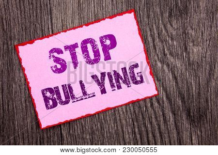Handwriting Announcement text showing Stop Bullying. Conceptual photo Awareness Problem About Violence Abuse Bully Problem written Pink Sticky Note Paper the wooden background. poster