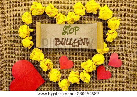 Handwriting Announcement text showing Stop Bullying. Concept meaning Awareness Problem About Violence Abuse Bully Problem written Sticky Note Paper With Heart the textured background poster