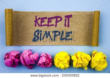 Handwriting text showing Keep It Simple. Concept meaning Simplicity Easy Strategy Approach Principle written tear sticky note Paper the blue background Folded paper poster