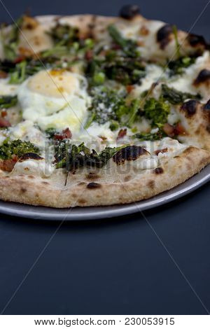 Close-up Of An Egg, Pancetta & Broccoli Pizza. Shot With Shallow Depth-fo-field.