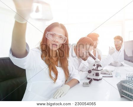 group of creative scientists working in a laboratory.