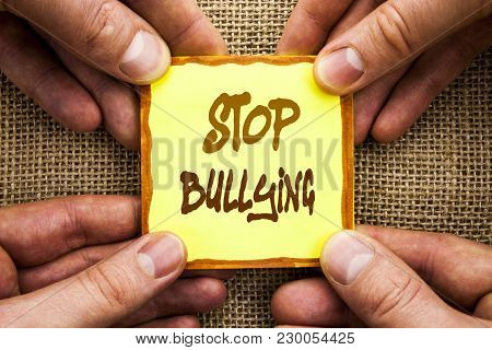 Conceptual hand writing showing Stop Bullying. Business photo showcasing Awareness Problem About Violence Abuse Bully Problem written Sticky Note Paper Holding Hand with Finger. poster