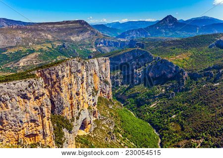 Steep picturesque cliff in the French Alps. The journey to the most beautiful canyon in Europe - Verdon. Concept of ecological, extreme and active tourism