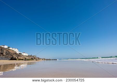 Calm sea and surf on a sandy beach. summer sea in Sunny weather with blue sky. Beautiful sandy beach and transparent waves