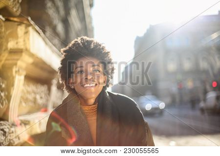 Smiling in the street