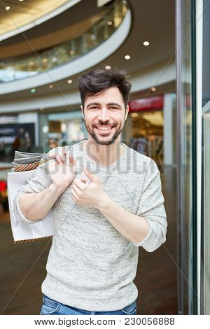 Young man as a consumer and customer in retail while shopping