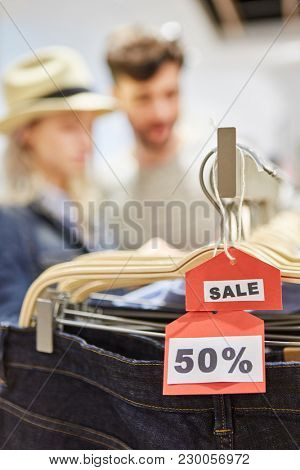 Price tag with 50% discount as a special offer in the fashion discount shop