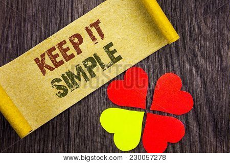 Word, writing, text  Keep It Simple. Conceptual photo Simplicity Easy Strategy Approach Principle written Sticky Note Paper with Love Heart Next to it the wooden background. poster