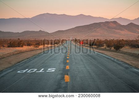Middle Of Desert Road Vanishing Point And Mountains
