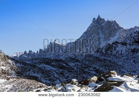 Panoramic View On Rocky Peaks Of Aiguille Du Midi In The French Alps