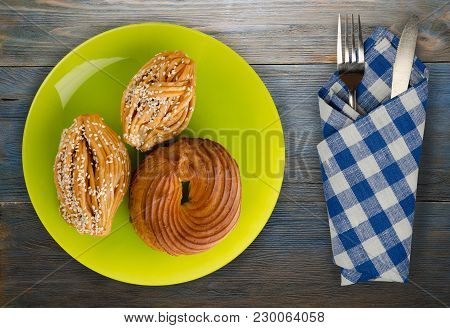 Three Cakes On A Plate. Cakes On A Wooden Background. Dessert Top View