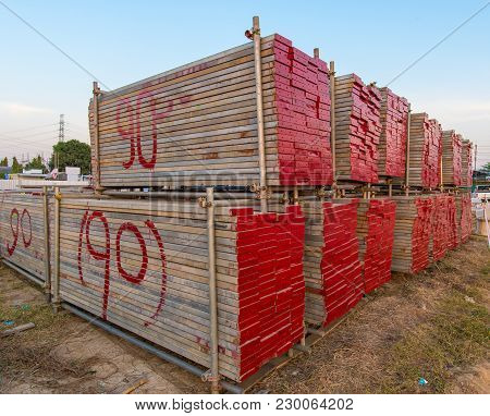 Red Platform Scaffolding And Steel Pipe For Scaffolding At Stock Area.