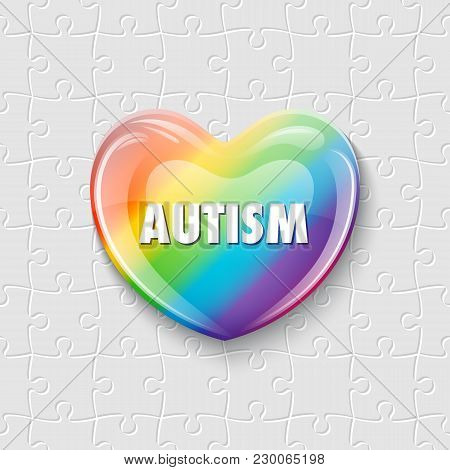World Autism Awareness Day. Colorful Iridescent Glass Heart On Puzzle Background. Symbol Of Autism.