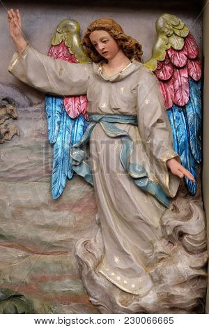 STITAR, CROATIA - NOVEMBER 30: Angel of the Lord visited the shepherds and informed them of Jesus' birth, altarpiece in the church of Saint Matthew in Stitar, Croatia on November 30, 2017.