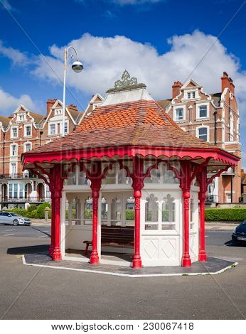 BEXHILL-ON-SEA, UK - JUN 4, 2013: Victorian wooden sea front shelter and seating at popular seaside resort Bexhill-on-Sea in East Sussex