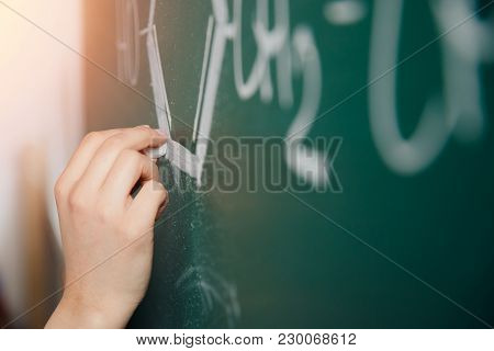 Chalk Board. Close-up Of Human Hand Writes Formulas On Physics And Chemistry In School And Universit