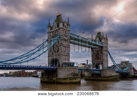 Famous Tower Bridge under cloudy sky in London, UK.