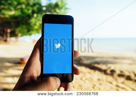 Krabi, Thailand - March 06, 2018: Closeup Of Iphone Screen With Twitter Startscreen At A Beach