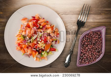 Vegan Food. Salad From Vegetables (pepper, Tomato, Onions, Broccoli) On A Plate. Vegan Salad On A Wo